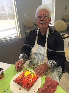 Gordon at at a painting class at Banksia Village, where he has lived since 2001