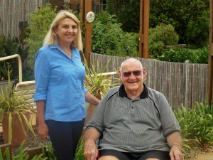 Banksia Lodge resident Alan C, pictured with staff member Jeanette